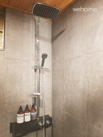 Shower booth and amenities
