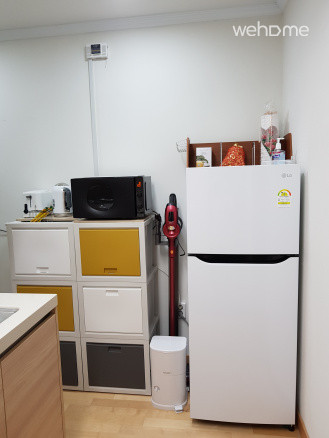 Kitchen with refrigerator and vacuum cleaner