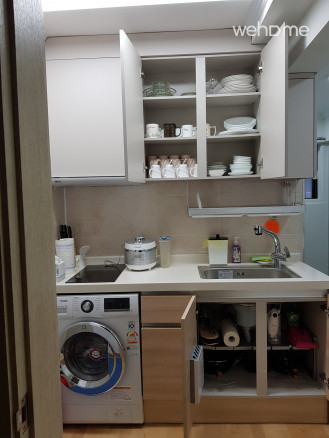 Kitchen with a rice cooker and utensils